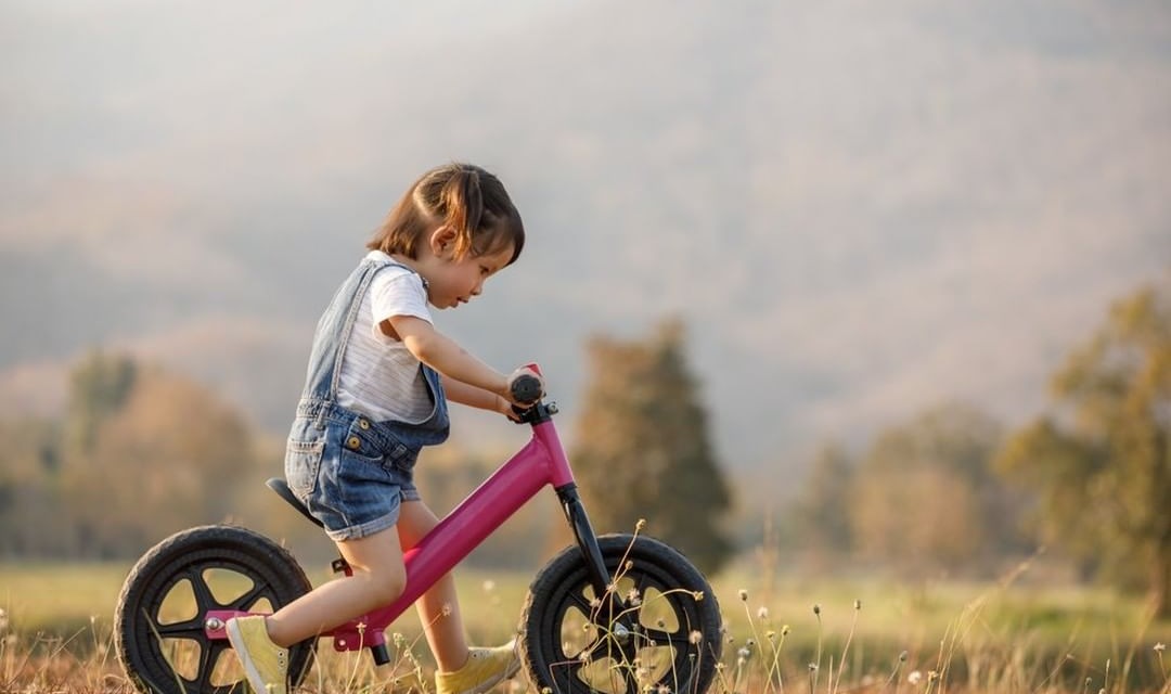 girl on balance bike